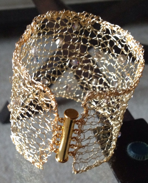 images/gold knitted cuff with swarovski crystals.jpg