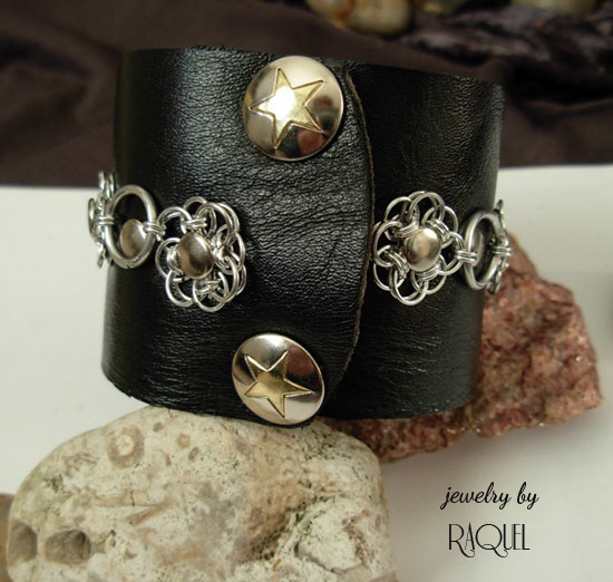 Black leather Rock N' Roll wrist band cuff with Flower scales